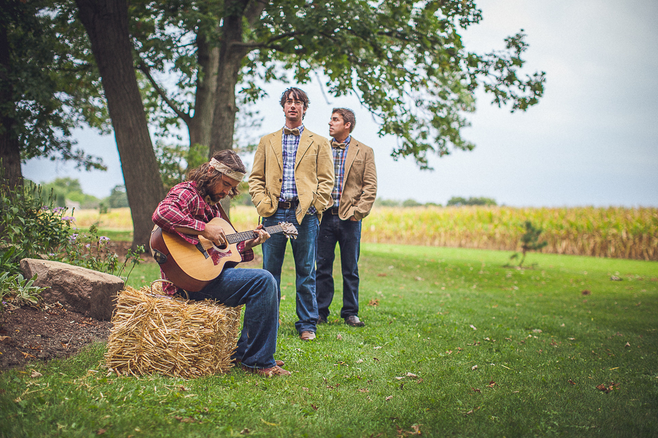 46 groomsman playing music for ceremony - Rural Chicago Wedding Photographer // Chantel + Chris
