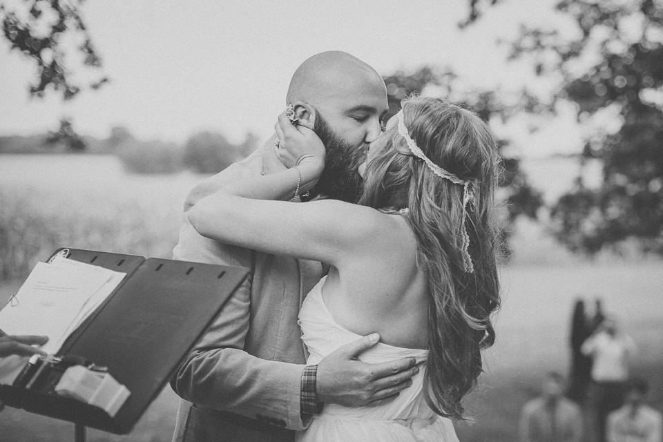 56 first kiss during ceremony - Rural Chicago Wedding Photographer // Chantel + Chris