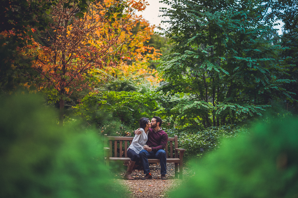 02 couple on bench kissing