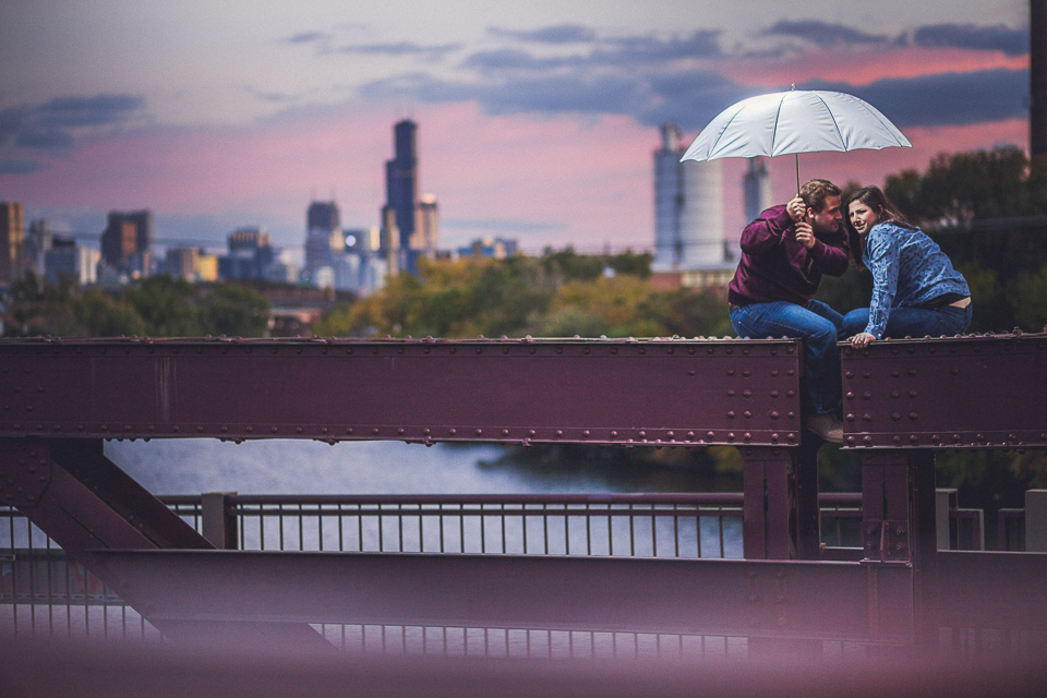 10 couple sitting on bridge