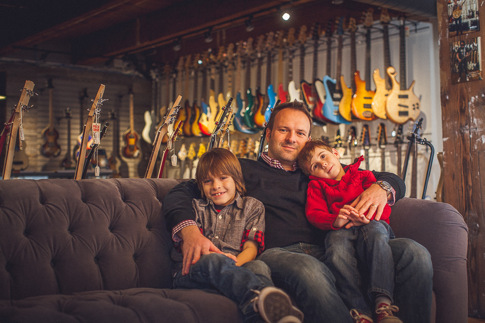 04 dad and two sons at music store peter gubernat photography - Schmidt Family Creative Portraits