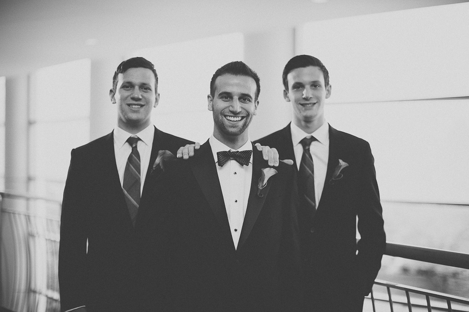 08 black and white portrait of groom with best men  chicago wedding photographer