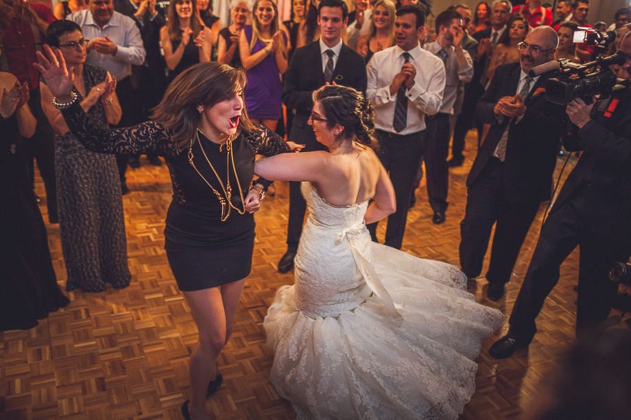 31 bride and friend dancing  chicago wedding photographer