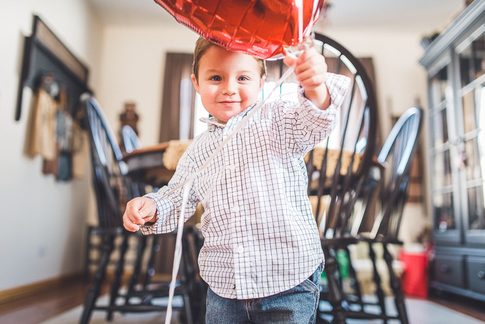 07 boy playing with balloon
