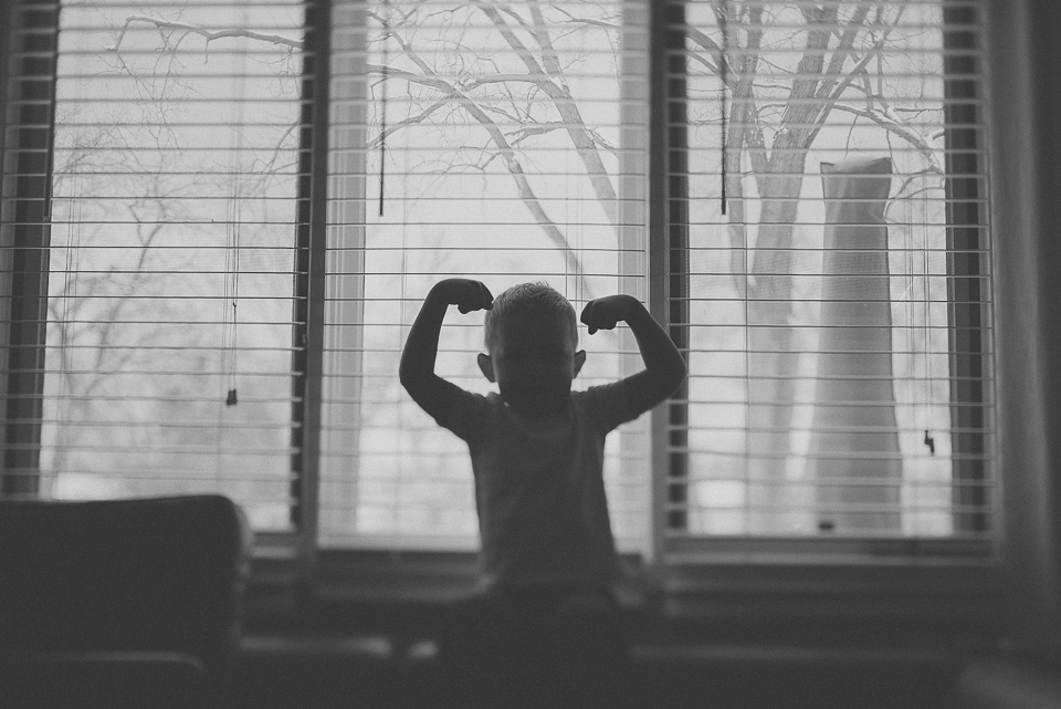 13 silhouette of boy in window family photo session