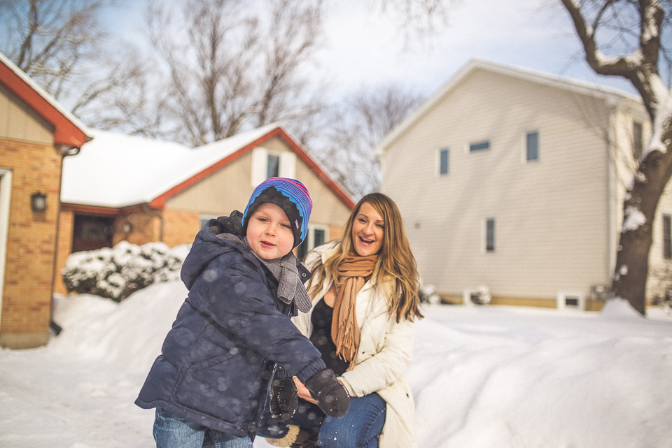14 cute boy throwing snowball - Maternity & Family Photography in Oakbrook <> Wojcicki Family