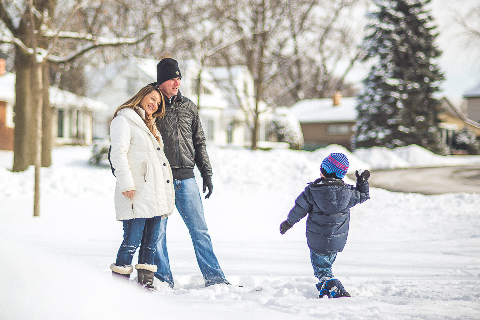 21 son throwing snowball at parents - Maternity & Family Photography in Oakbrook <> Wojcicki Family