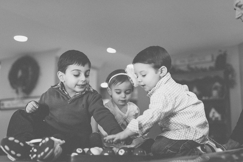 22 black and white photo of kids playing on pool table