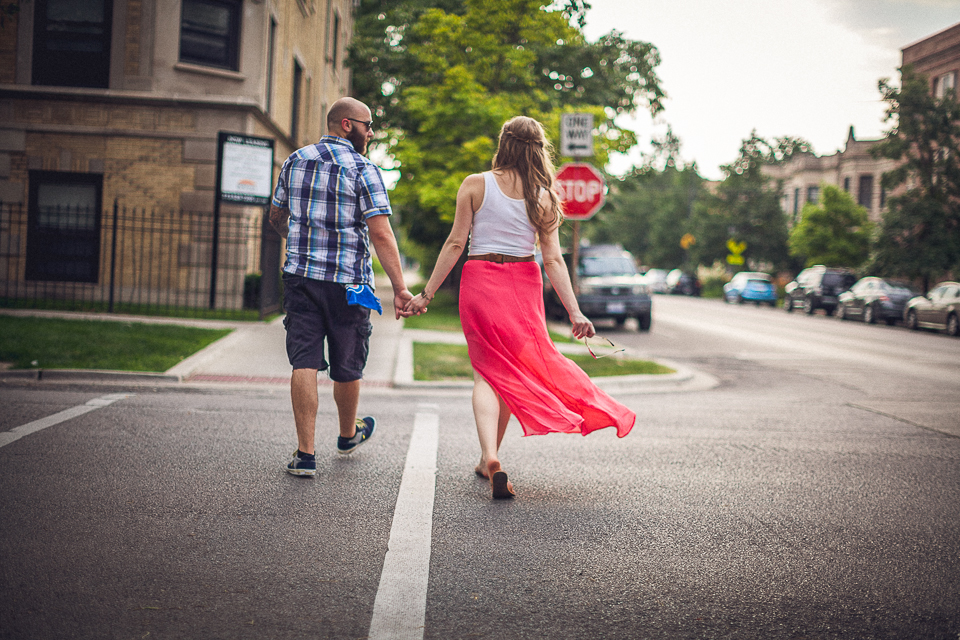 couple wakling during chicago engagement session