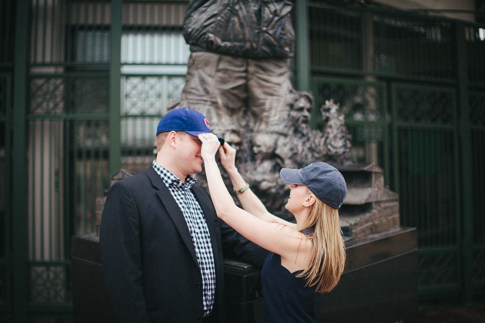 putting on cubs hats during engagement session