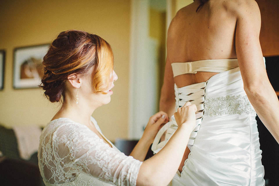 15 bride putting on dress