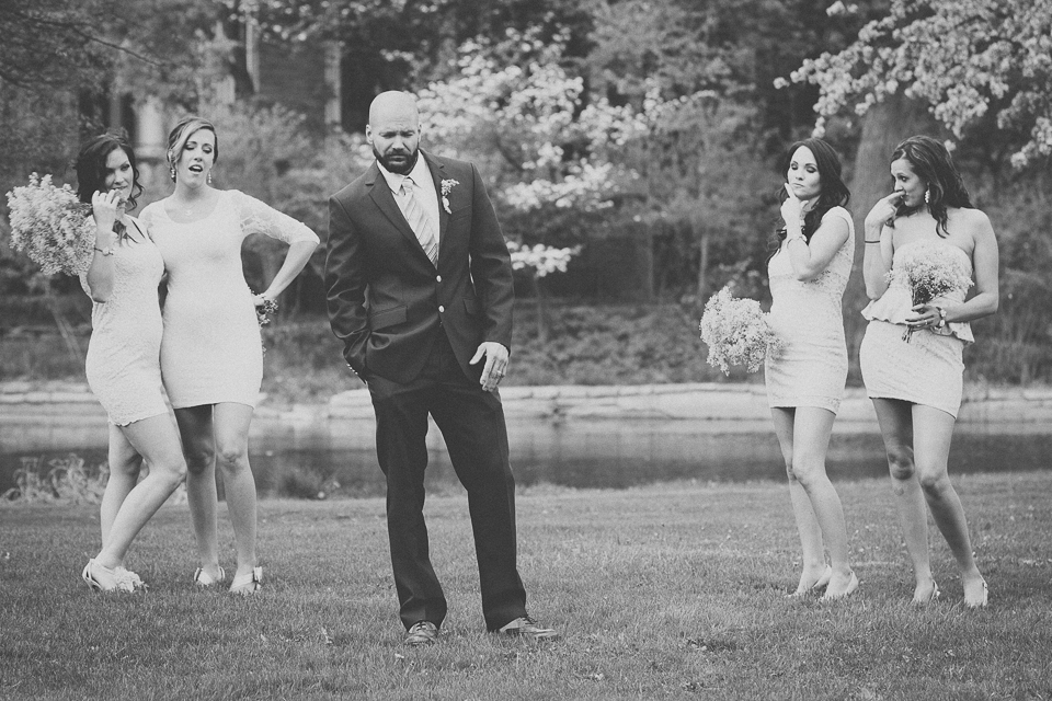52 black and white of groom and bridesmaids being funny
