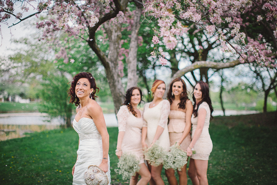 53 bride and her bridesmaids under a tree laughing