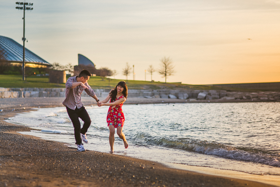 05 playing on the beach in chicago - Chicago IL Engagement Photos // Anne + Dennis