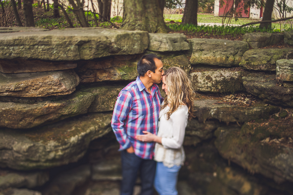 09 couple in love by rocks - Sam + Jason // Grosse Point Evanston IL Engagement Session