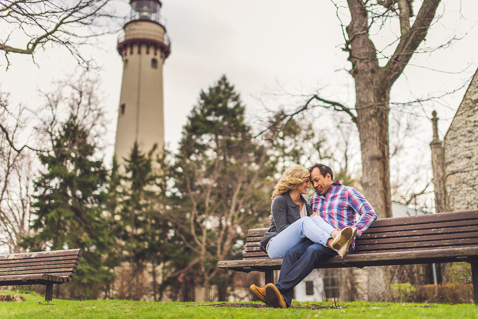 10 couple cuddling by lighthouse - Sam + Jason // Grosse Point Evanston IL Engagement Session