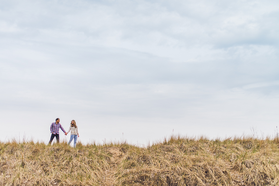 11 walking on the beach grass - Sam + Jason // Grosse Point Evanston IL Engagement Session