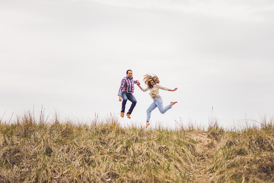 12 fun couple jumping on engagement shoot
