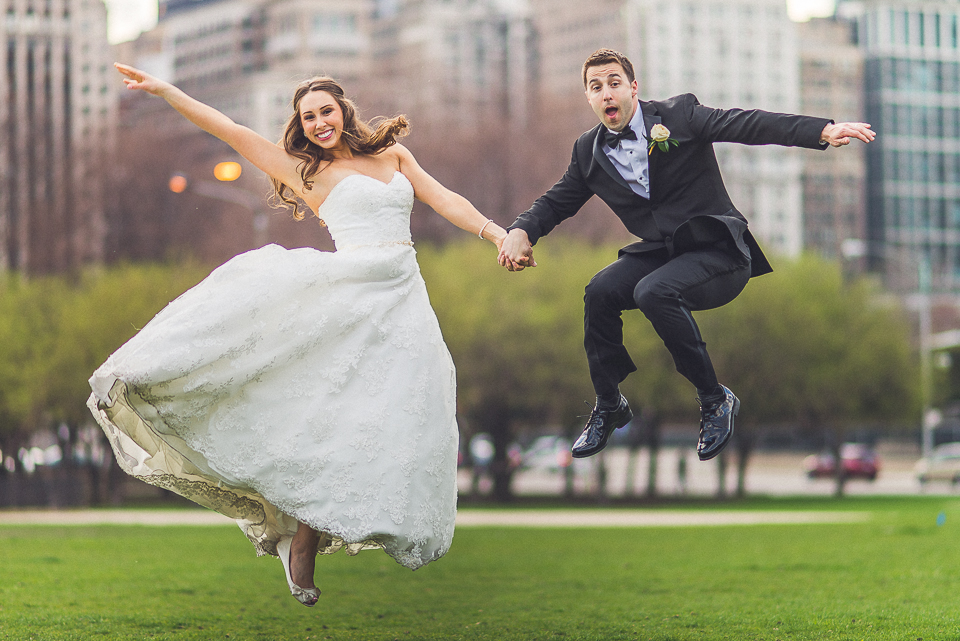 104 bride and groom jumping - Downtown Chicago Wedding Photography // Mandy + Tim