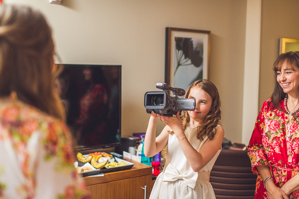 14 talking on camera - Downtown Chicago Wedding Photography // Mandy + Tim