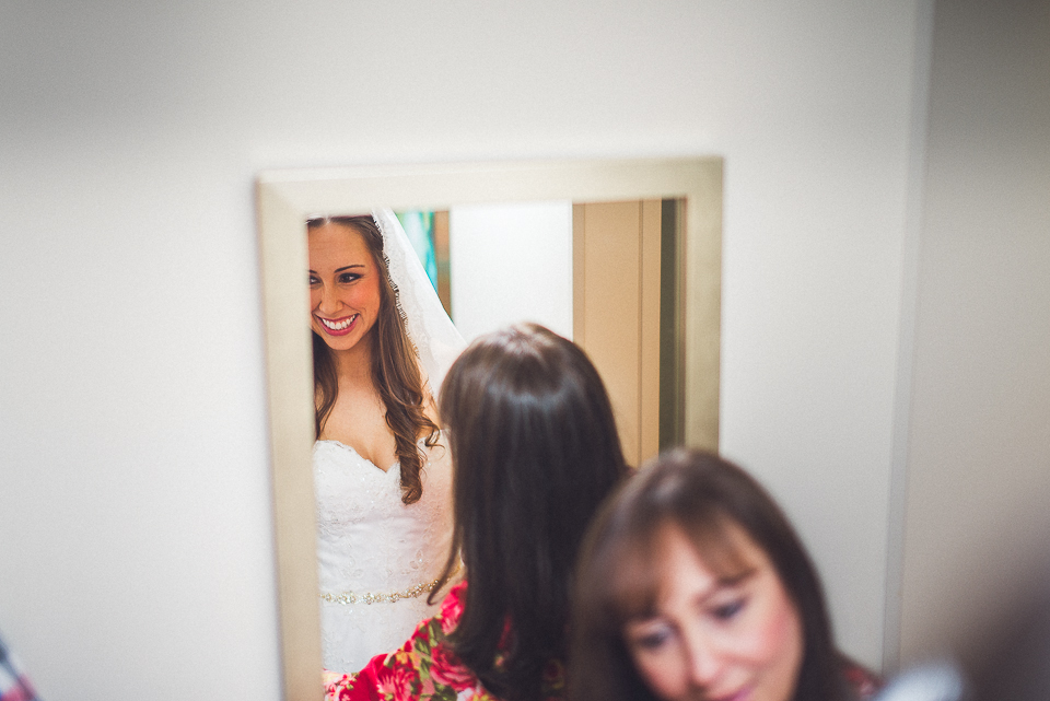 23 bride putting on vail - Downtown Chicago Wedding Photography // Mandy + Tim