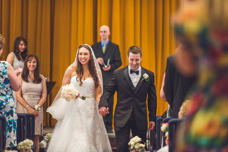 44 married and coming down the isle - Downtown Chicago Wedding Photography // Mandy + Tim