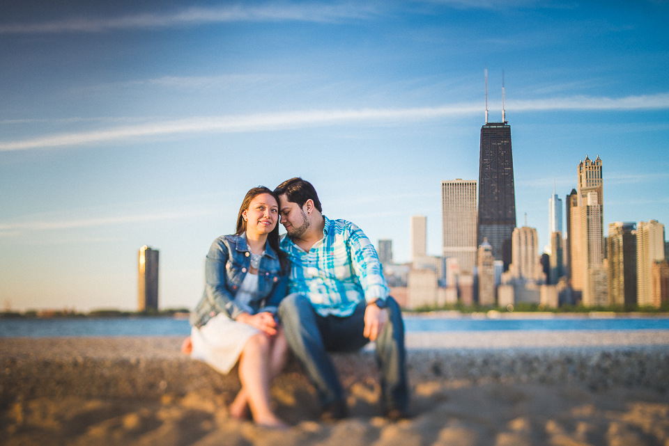 08 sittign at north avenue beach - Juan + Carla // Downtown Chicago Lakefront Engagement Session