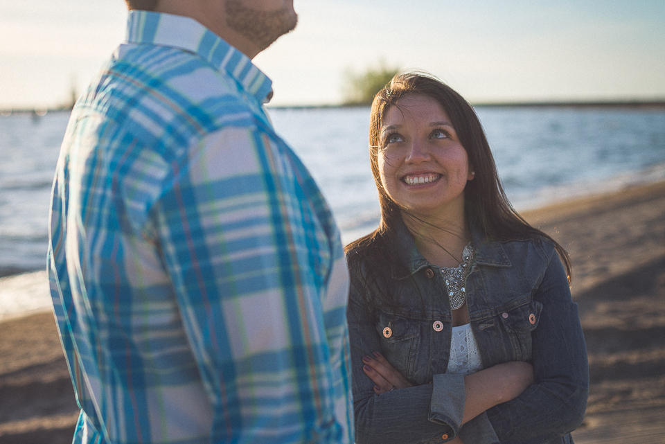 12 smiling at juan during engagement session in chicago - Juan + Carla // Downtown Chicago Lakefront Engagement Session