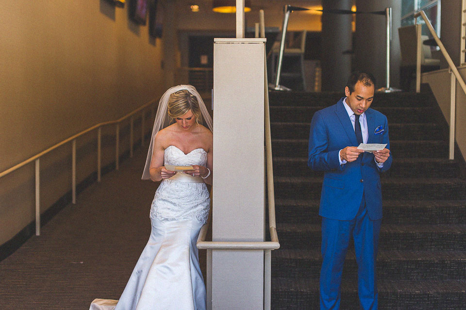 14 reading letters in hotel - Sam + Jason // Chicago Wedding Photographer
