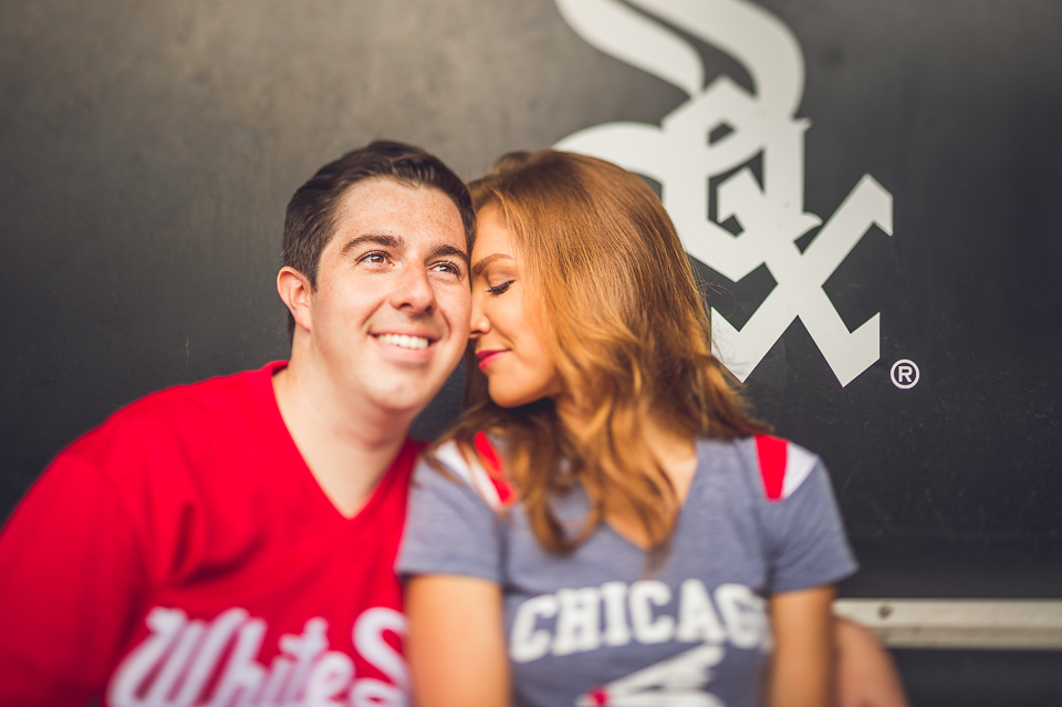 21 engagement photos in the sox dug out