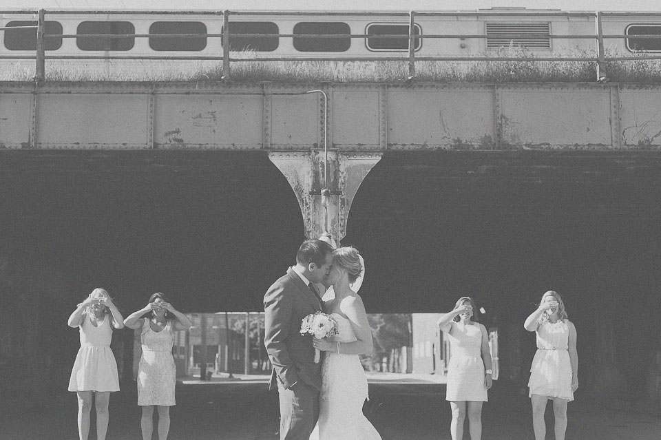23 bride and groom kissing by train in chicago