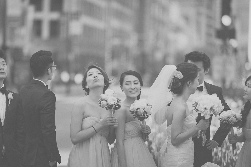 34 bridal party having fun on michican avenue in chicago - Michael + Haley // Chicago Wedding Photographer - Intercontinental Hotel