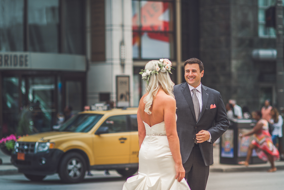 21 bride and groom first look on michigan avenue in chicago