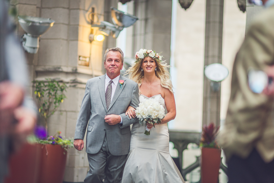 39 bride and father walking down the isle in chicago