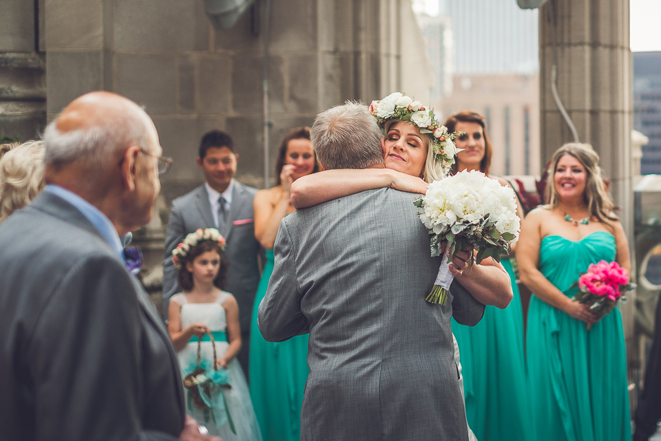 40 bride hugs her father