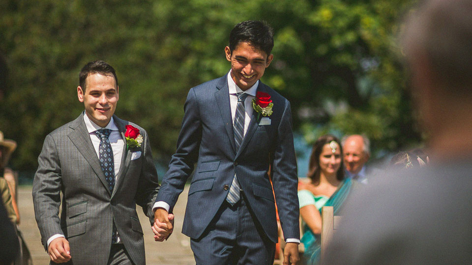 11 grooms happy walking down the isle at same sex wedding - Chicago Wedding Photographers // Sal + David
