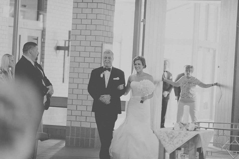 16 bride walking down the isle with father