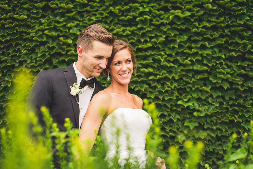 30 bride and groom with ivy in omaha