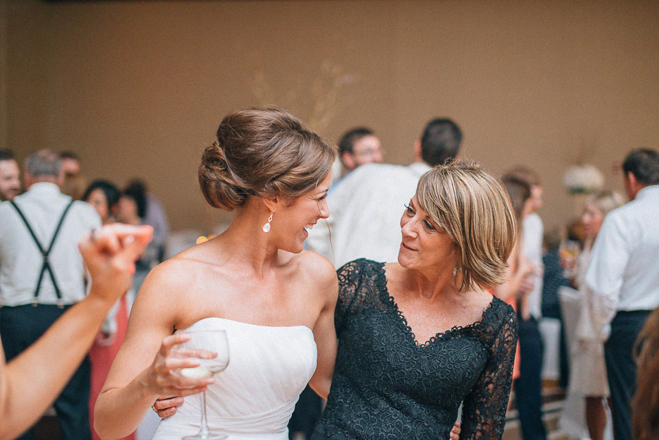 57 bride and mom dancing
