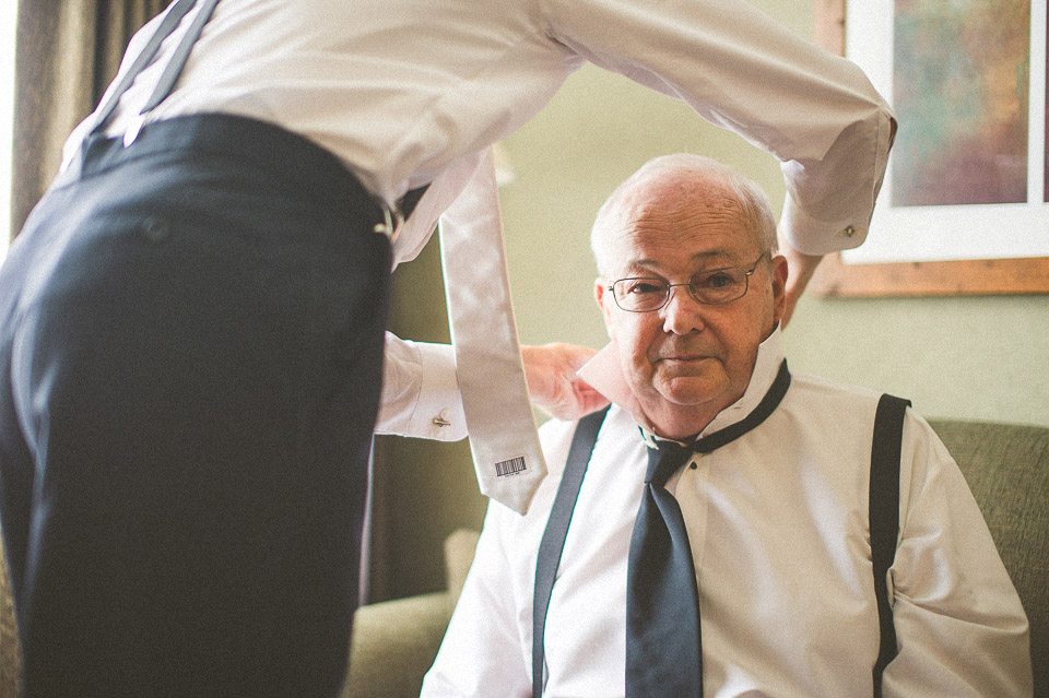 12 groom helping father in law - Susan + Jack // Lake Geneva Wedding Photography