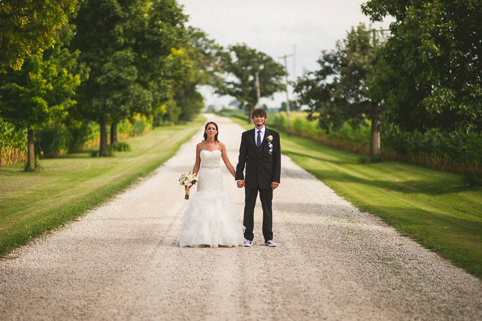 artistic bride and groom portrait on a farm road near NIU