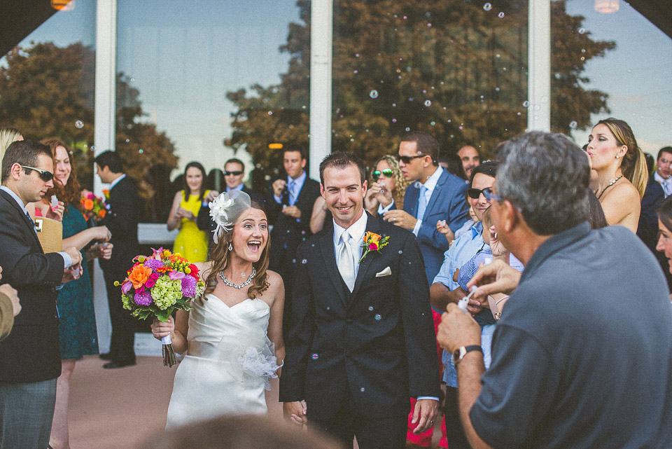 30 bubbles as bride and groom exit - Susan + Jack // Lake Geneva Wedding Photography