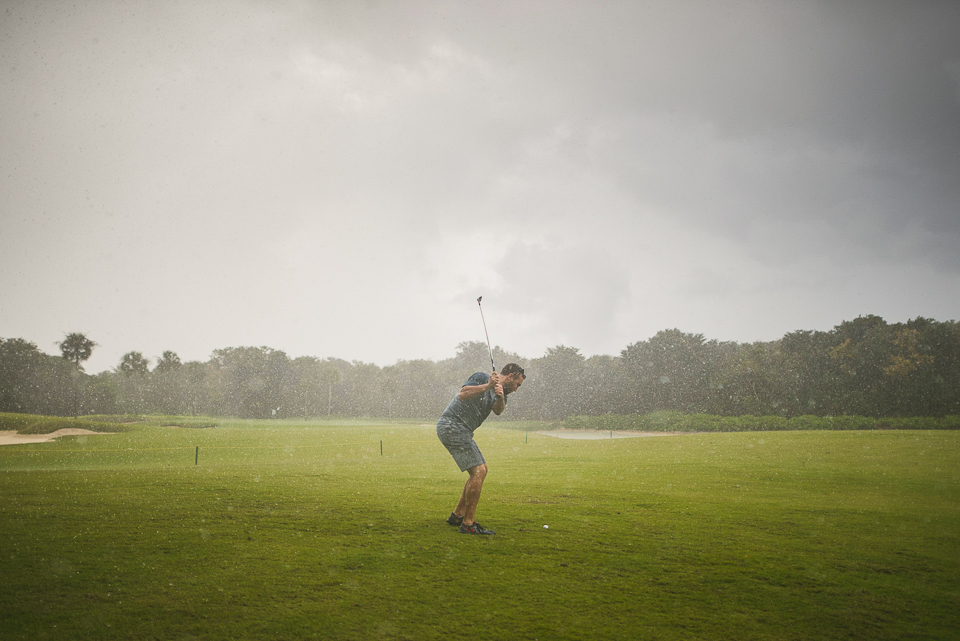 14 groom golfing while raining