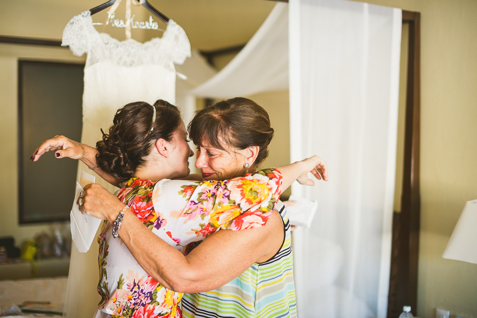 19 bride and mom hugging