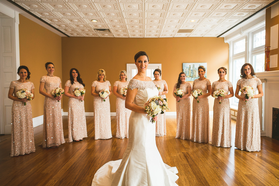 11 bride and bridesmaids posed
