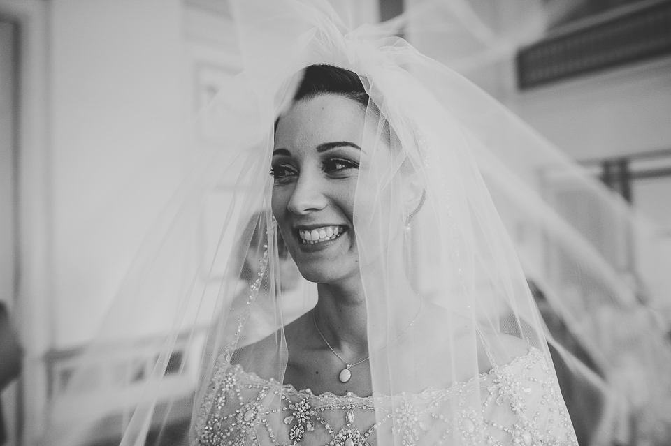 17 smiling bride in veil - Pam + Vinny // Chicago Wedding Photographer