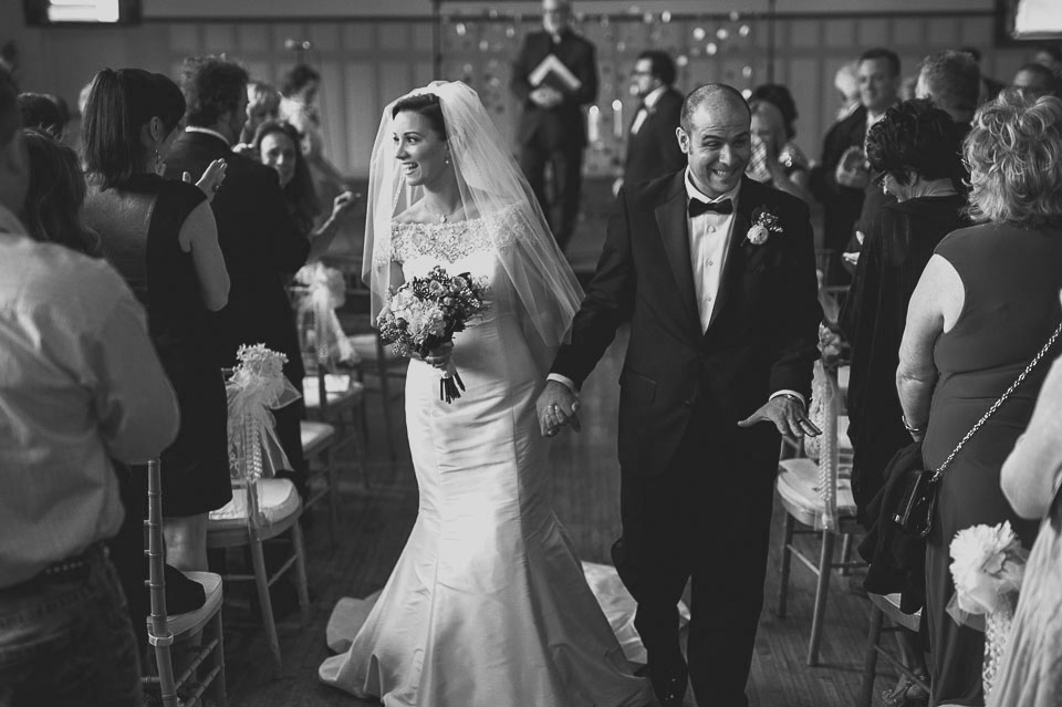 24 recessional happy bride and groom - Pam + Vinny // Chicago Wedding Photographer