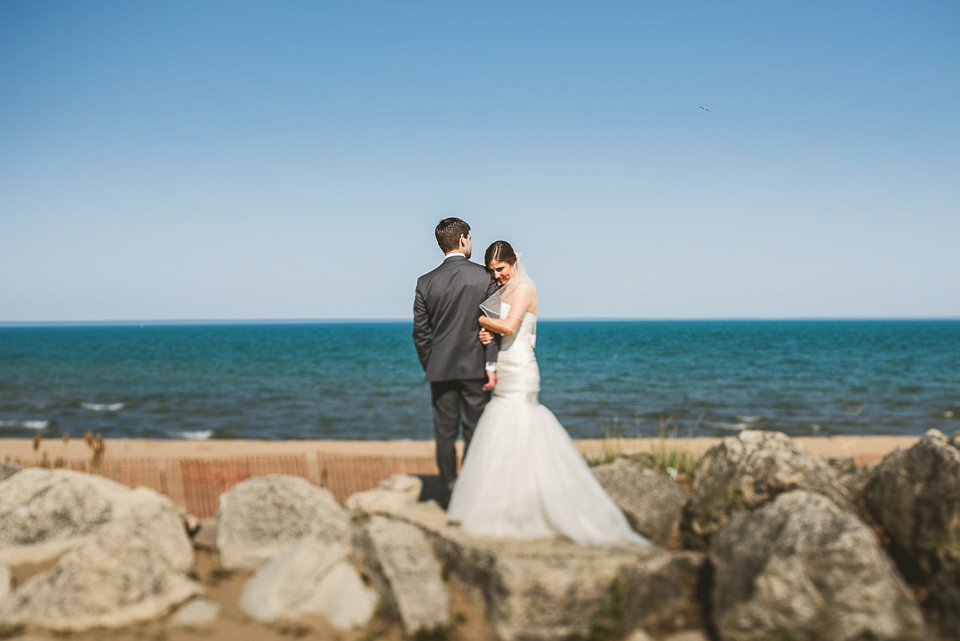 31 bride and groom on beach - Mandy + Brian // Chicago Wedding Photographer