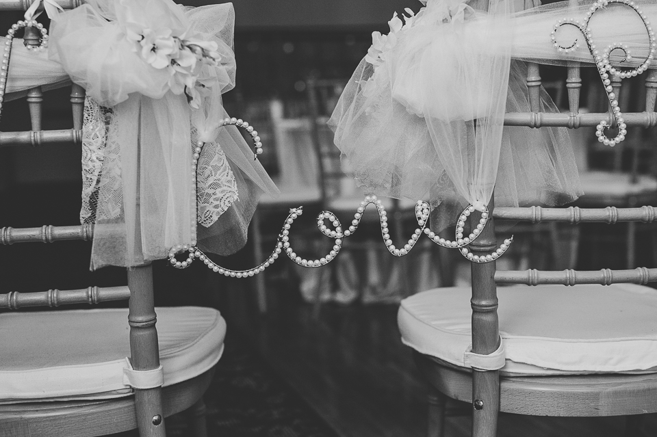31 love on chairs - Pam + Vinny // Chicago Wedding Photographer