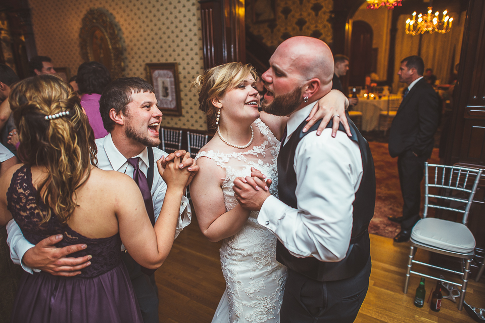77 bride and groom having fun at wedding - Gintare + AJ // Chicago Wedding Photography